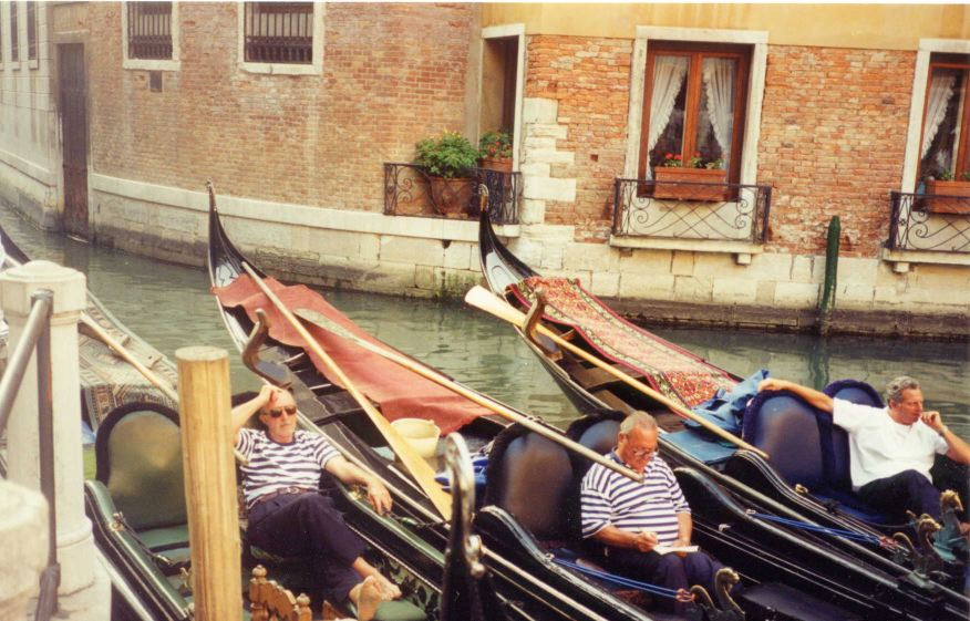 Photo: Gondoliers relax before the tourist rush hour